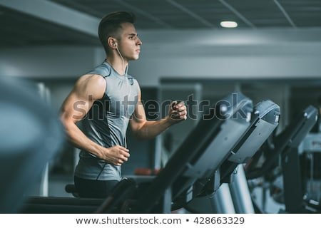 muscle man exercise on sport gym fitness club stock photo © lunamarina