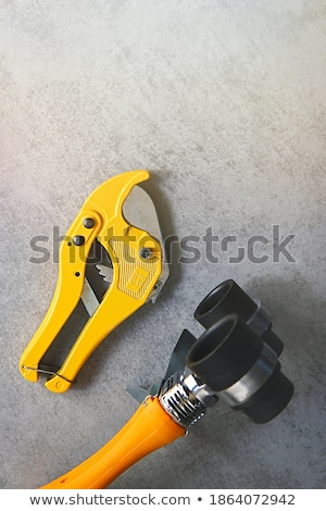 Plumber cutting grey pipe Stock photo © photography33