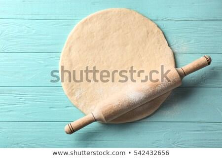 closeup of a rolling pin on dough stock photo © rob_stark