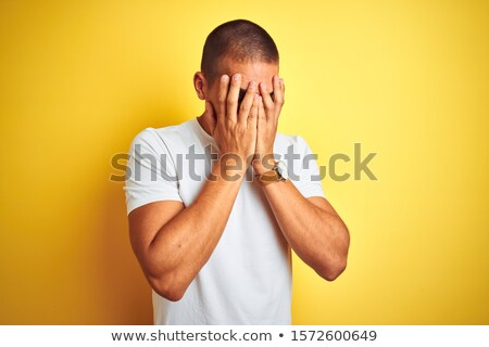 depressed man with hands over face Stock photo © 808isgreat