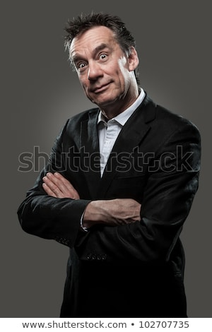 Surprised Business Man on Grey Background High Contrast Look Stock photo © scheriton