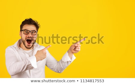 Excited man pointing to a sign Stock photo © photography33