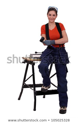 Woman with a floor tile and a mallet Stock photo © photography33