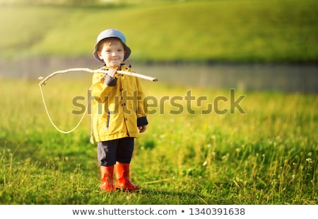 """Boy catches the """"fish"""" in the park amusement stock photo © Traven"""