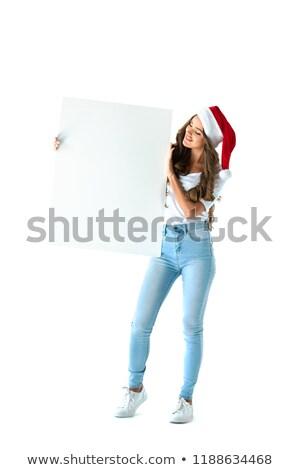 Nő mikulás kalap tart üres tábla Stock fotó © prg0383