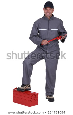 tradesman with his foot propped on a toolbox stock photo © photography33