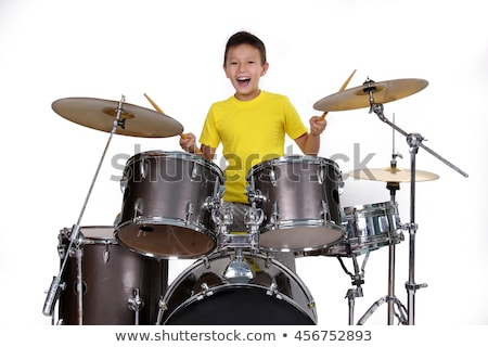 Stock photo: Young playing drums