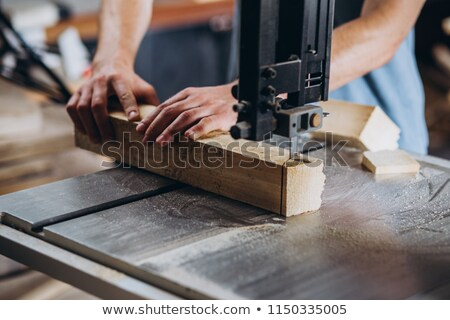 female carpenter sawing a plank stock photo © photography33