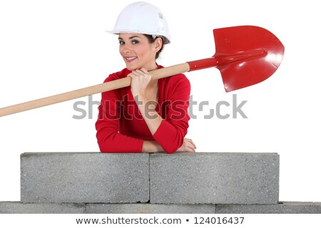 Woman with shovel leaning against a wall Stock photo © photography33
