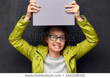 Mad woman screaming at someone against a white background Stock photo © wavebreak_media