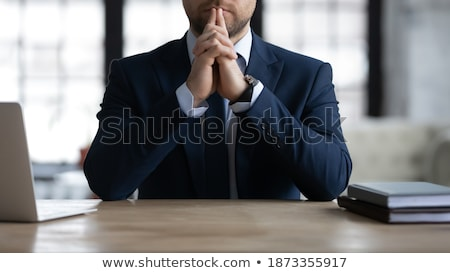 Meditative businessman touching the chin Stock photo © pablocalvog