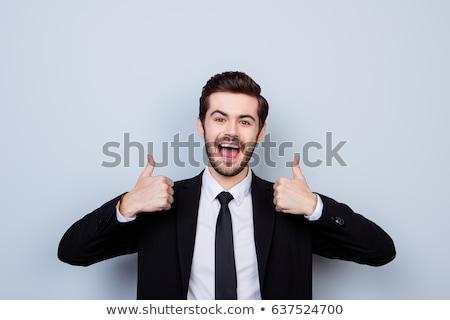 sorridente · moço · polegar · para · cima · branco · mão - foto stock © wavebreak_media