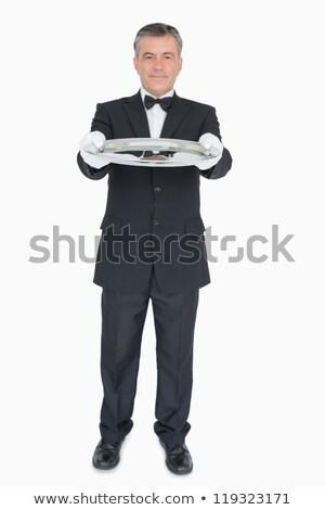 Pincér öltöny mutat üres tálca boldog Stock fotó © wavebreak_media