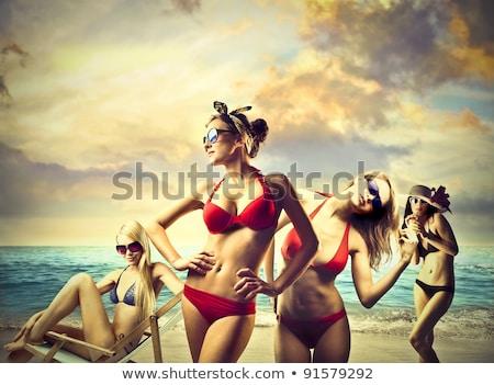beautiful brunette woman in bikini resting on the beach summert stock photo © victoria_andreas