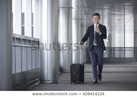vista · lateral · Asia · hombre · de · negocios · caminando · feliz - foto stock © szefei
