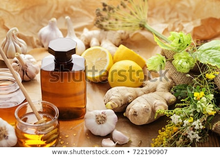 Stock photo: medicinal tincture with honey
