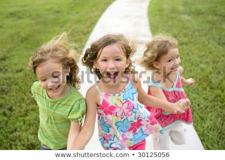 Stockfoto: Three Sister Girls Playing Running On The Park
