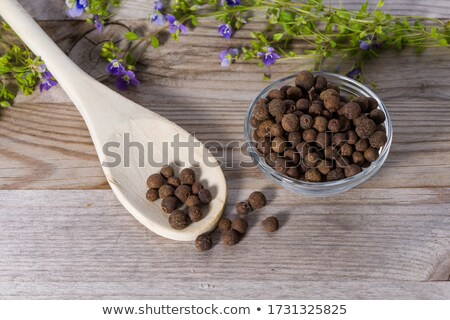 pimento peppercorns macro on wooden board Stock photo © Mikko