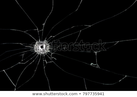 Crime: Destructed Pieces of Shattered glass with bullet hole Stock photo © Arsgera