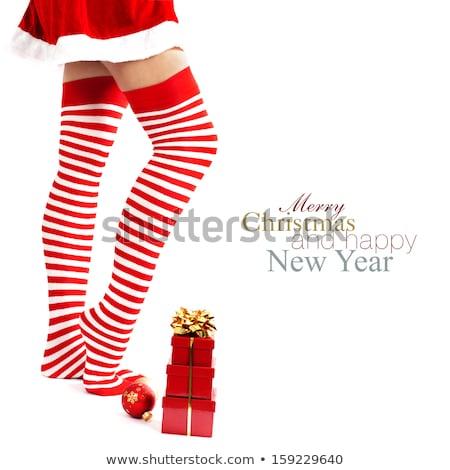 Woman legs in colourful stockings on white Stock photo © Elnur