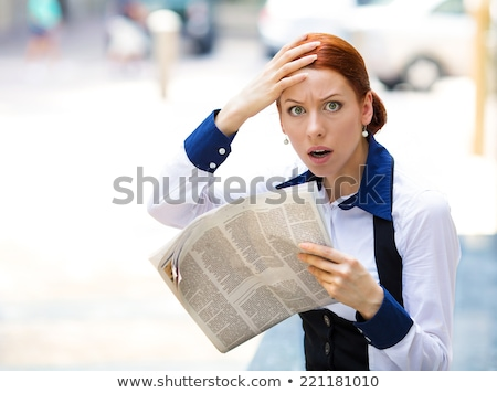 Woman shocked by newspaper article Stock photo © photography33