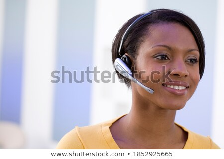 confident smiling female telecaller stock photo © stockyimages