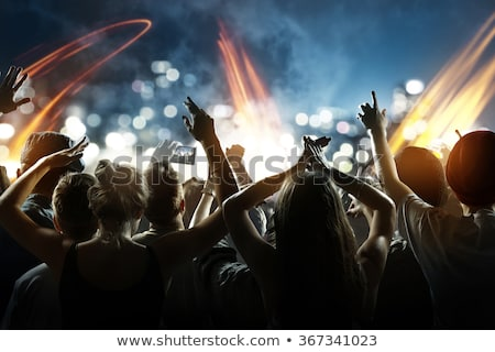 people dancing in club with laser stock photo © kzenon