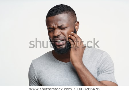 man having tooth ache stock photo © ichiosea