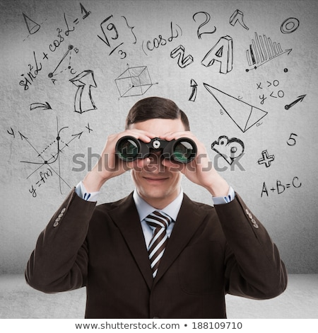 Stock photo: Teacher math symbols overhead