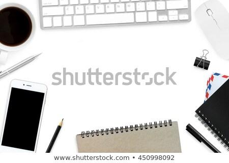 Wireless phone and blank envelope on tabletop Stock photo © stevanovicigor