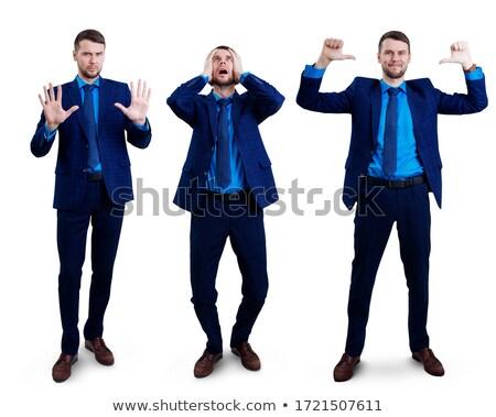 happy businessman with hands up stock photo © dolgachov