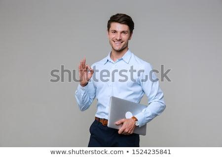 businessman - confident laptop stock photo © dgilder