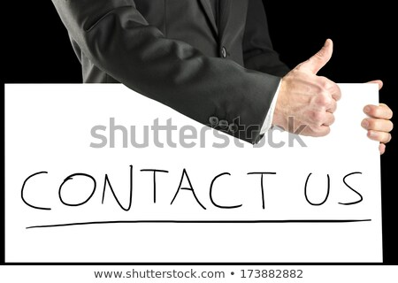 businessman giving thumb up as sign of endorsement stock photo © stevanovicigor