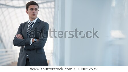 Businessman standing urban surrounding arms crossed Stock photo © HASLOO