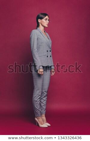 Beautiful young woman wearing business outfit full body shot stock photo © darrinhenry