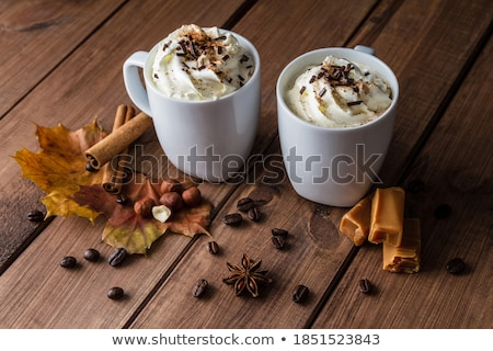 Two cinnamon sticks, chocolate and coffee beans Stock photo © raphotos