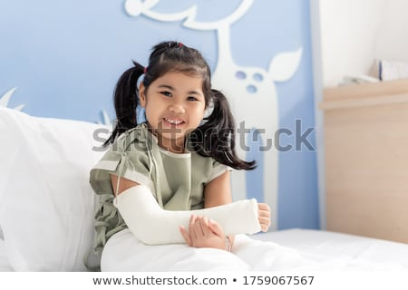 Sick girl with a fracture Stock photo © AlexBannykh