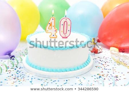 Birthday cake with burning candle number 40 Stock photo © Zerbor