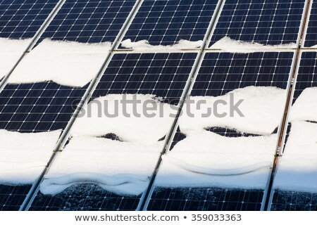 Stock photo: Solar modules with snow