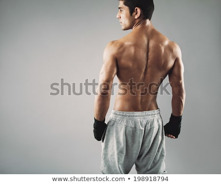 Shirtless gespierd man permanente grijs Stockfoto © stryjek