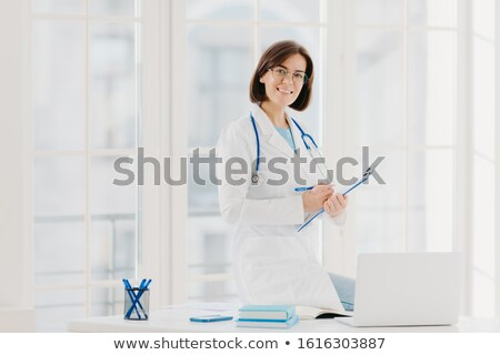 Health care person ready to write patient information Stock photo © Klinker