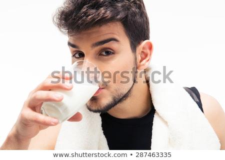 Sports man drinking milk Stock photo © deandrobot