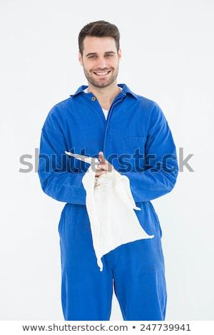 Mechanic wiping hands with cloth Stock photo © wavebreak_media