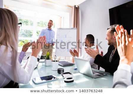 Stock photo: Business team applauding their colleague
