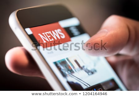 phone with news article on screen Stock photo © netkov1
