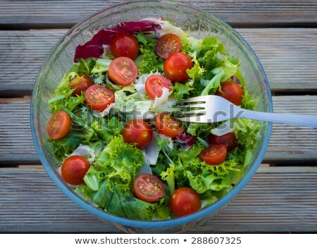 lettuce salad and cherry tomatoes on a wood background Stock photo © master1305