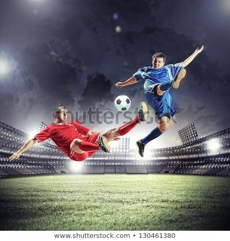 football player striking the ball at the stadium Stock photo © nenetus