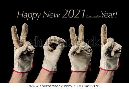 man with leather construction glove and number one gesture stock photo © feverpitch