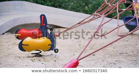 Empty swings on playground Stock photo © Fesus