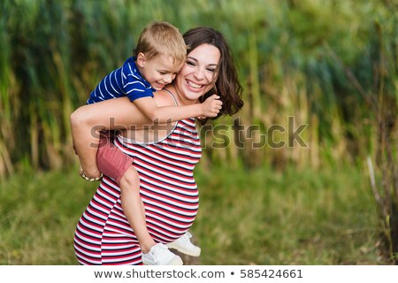Pregnant Woman Plays With Little Boy Stock fotó © O_Lypa